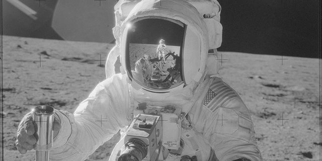 Apollo 12 astronaut Alan Bean, photographed by Cmdr. Pete Conrad (reflected in visor) in November of 1969.