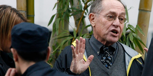U.S. Professor of Law at Harvard University Alan Dershowitz talks to federal police agent after being ejected of the hotel were Iranian President Mahmoud Ahmadinejad and Swiss President Hans-Rudolf Merz were meeting in Geneva April 19, 2009.
