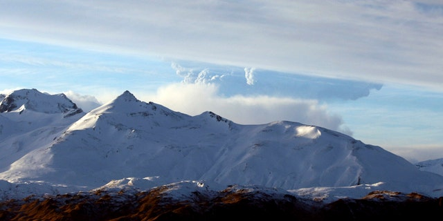 This photo taken Dec. 21, 2016 and provided by Lynda Lybeck Robinson shows the Bogoslof Volcano erupting in the Aleutian Islands, Alaska. The active Alaska volcano, which has erupted 10 times since mid-December and is located about 850 miles southwest of Anchorage, erupted again Thursday, Jan. 5, 2017, this time sending a cloud of ash and ice 35,000 feet in the air. (Lynda Lybeck Robinson via AP)