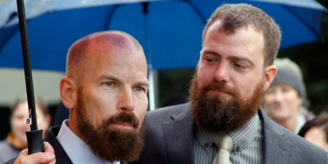 Oct. 10, 2014: Matthew Hamby, left, and Christopher Shelden speak during a news conference following a hearing.