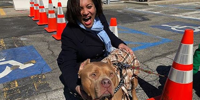 New York state Sen. Marisol Alcantara, D-Manhattan, poses with a dog.