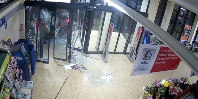 The ATM can be seen near the door as the Land Rover starts to smash through.