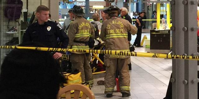 Emergency responders staged inside the Northlake Mall.