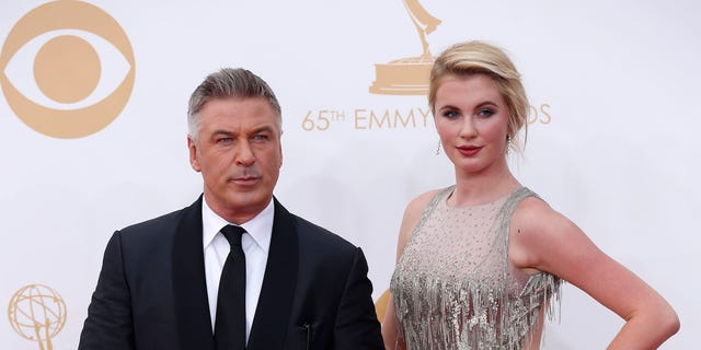 "Actor Alec Baldwin, from the NBC sitcom ""30 Rock,"" arrives with his daughter Ireland at the 65th Primetime Emmy Awards in Los Angeles September 22, 2013.  REUTERS/Mario Anzuoni (UNITED STATES  - Tags: ENTERTAINMENT)  (EMMYS-ARRIVALS) - RTX13VQY"