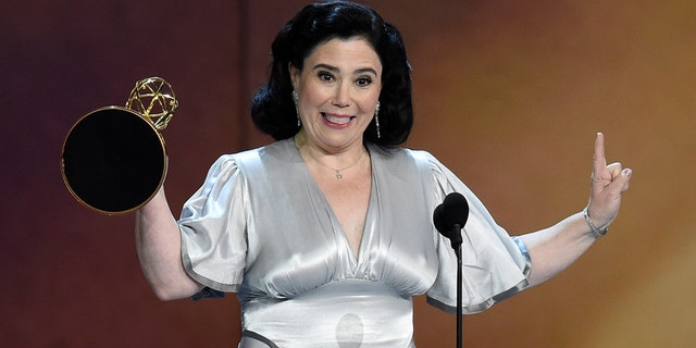 """Alex Borstein accepts the award for outstanding supporting actress in a comedy series for """"The Marvelous Mrs. Maisel"""" at the 70th Primetime Emmy Awards on Monday, Sept. 17, 2018, at the Microsoft Theater in Los Angeles."""