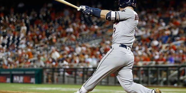 Houston Astros Alex Bregman (2) hits a solo home run in the 10th inning during the Major League Baseball All-Star Game, Tuesday, July 17, 2018 in Washington.