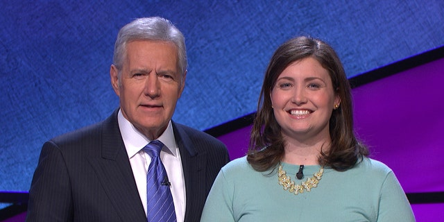 """January 2014. Alex Trebek, left, host of the TV show """"Jeopardy!"""" poses with contestant Julia Collins, 31, of Kenilworth, Ill., during the taping of her shows."""