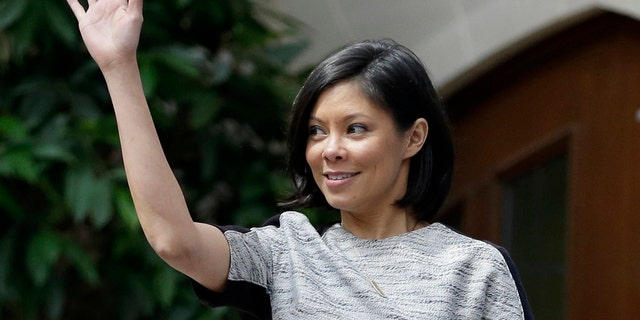 """This April 6, 2013, file photo shows MSNBC host Alex Wagner waving to the crowd before moderating a session on human trafficking during the Clinton Global Initiative at Washington University in St. Louis. Showtime said it will keep its political show """"The Circus"""" despite the loss of Mark Halperin, axed due to sexual misconduct charges. He's being replaced by CBS News' Wagner, who joins holdovers John Heilemann and Mark McKinnon."""