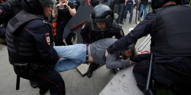 A protester is detained by riot police during an anti-corruption protest organized by opposition leader Alexei Navalny, on Tverskaya Street in central Moscow, Russia June 12, 2017.