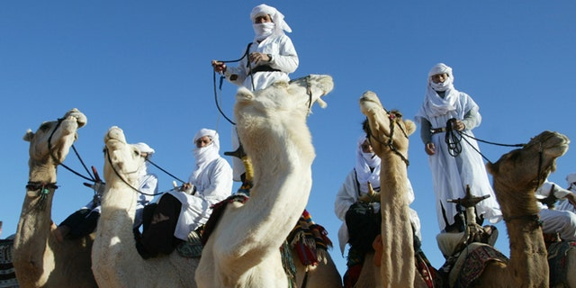 In this Dec. 12, 2002 file photo Tuaregs are shown on their camels outside Ghardaia, southern Algeria. The awe-inspiring dunes and wild mountains of Algerias Sahara have lured adventure travelers for decades, but their latest incarnation -- as a crossroad for the Al Qaeda militants who attacked a natural gas complex -- is likely to make them even more inaccessible.