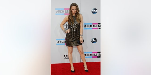 November 24, 2013. Actress Alicia Silverstone arrives at the 41st American Music Awards in Los Angeles, California.