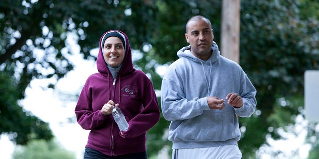 """December 11, 2011: Nawal Aoude, a pediatric respiratory therapist, left, and her husband Nader go for a walk in a scene from the TLC series, """"All-American Muslim."""""""