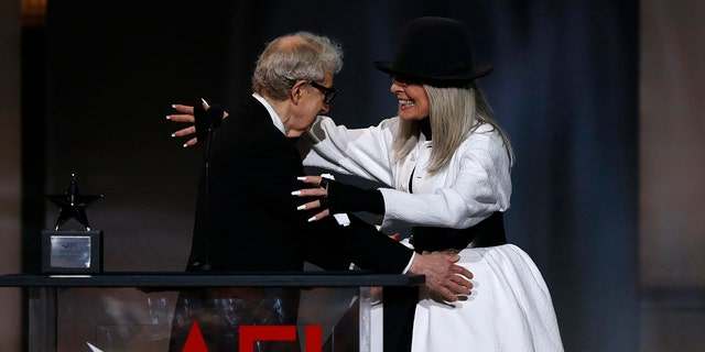 2017 American Film Institute Life Achievement Award  – Show – Los Angeles, California, U.S., 08/06/2017 - Actress Diane Keaton embraces director Woody Allen as she arrives on stage to receive an award in her honor. REUTERS/Mario Anzuoni - HP1ED690EHT2K