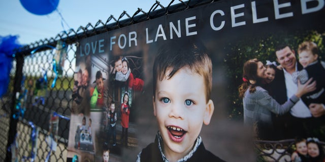 Banners hang on display with blue balloons and ribbons during a celebration of Lane Graves.