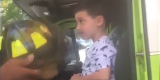 The boy got to meet firefighters after helping to save his family.