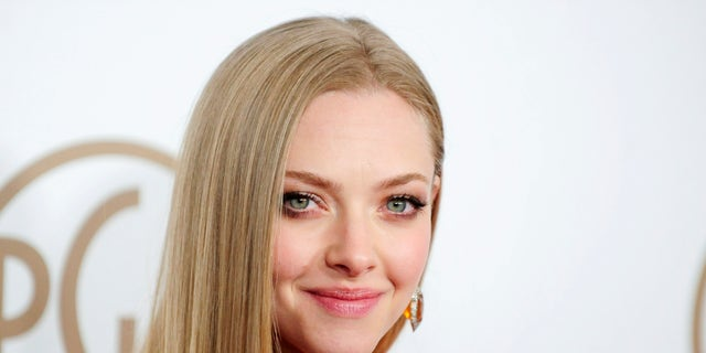 Actress Amanda Seyfried arrives at the Producers Guild of America Awards in Beverly Hills, California Jan. 26, 2013.