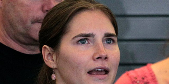This Oct. 4, 2011 file photo shows Amanda Knox speaking at a news conference shortly after her arrival at Seattle-Tacoma International Airport in Seattle. The appellate court in Italy that cleared Knox in the slaying of her British roommate has released the reasoning behind its ruling. The appellate court released its 144-page reasoning for reversing the earlier verdict on Thursday, Dec. 15, 2011.
