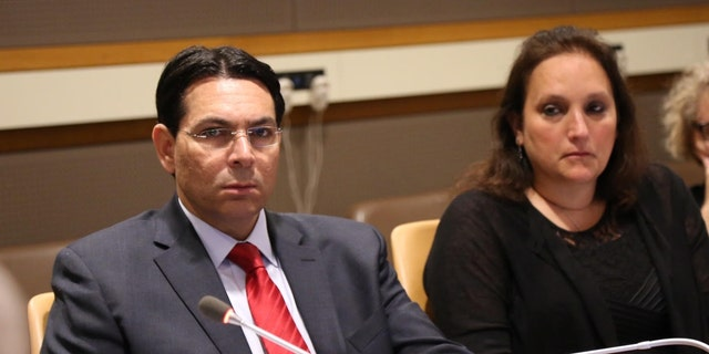 Israel's UN Amb. Danny Danon with Ruth Schwartz, whose son was killed in Israel, during a UN forum on Wednesday.