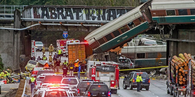 Dec. 18, 2017: Cars from an Amtrak train that derailed lie spilled onto Interstate 5 in DuPont, Wash.