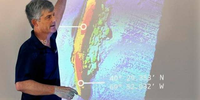 OceanGate CEO and co-founder Stockton Rush speaks in front of a projected image of the wreck of the ocean liner SS Andrea Doria during a presentation on Monday, June 13, 2016, in Boston, of findings after an undersea exploration earlier this month of the wreck in the Atlantic Ocean near Nantucket.