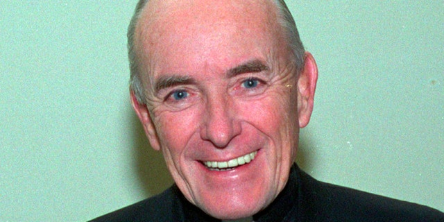 This 1992 file photo shows Rev. Andrew Greeley, an outspoken Roman Catholic priest, prolific best-selling novelist and Chicago newspaper columnist whose career spanned five decades. His longtime publicist said that Greeley died Wednesday, May 29, 2013, at his home in Chicago. He was 85.