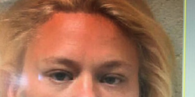 Angela Rainbolt is accused of harboring her fugitive brother, Brian Moody