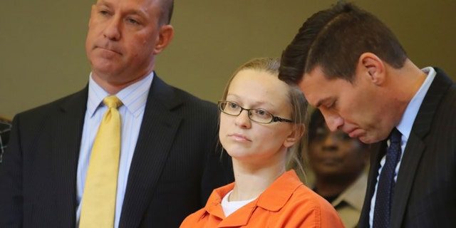 Angelika Graswald standing in court with her attorneys Jeffrey Chartier, left, and Richard Portale, right.