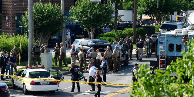 Police on the scene of the shooting in Annapolis, Md.