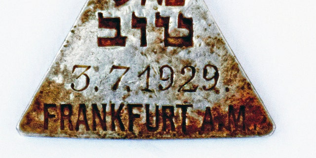 This undated photograph released by the Israel Antiquities Authority shows a pendant that appears identical to one belonging to Anne Frank, Israel's Yad Vashem Holocaust memorial said Sunday.