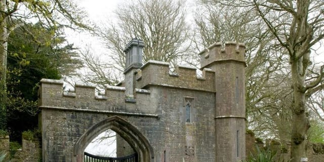 The Gothic-style castle is nestled on a quiet country road.