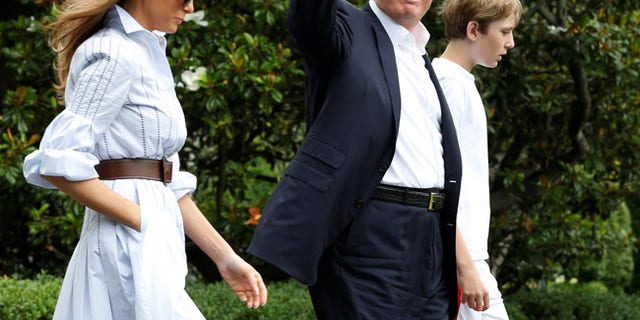 U.S. President Donald Trump with first lady Melania and their son Barron walk out from the White House in Washington, U.S., before their departure to Camp David, June 17, 2017. REUTERS/Yuri Gripas - RTS17H1T