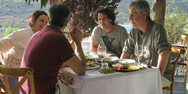 """Bourdain traveled all over the world on his culinary adventures on """"Parts Unknown."""" He's pictured here on a trip to Israel."""