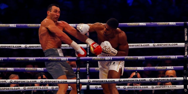 Britain Boxing - Anthony Joshua v Wladimir Klitschko IBF, IBO & WBA Super World Heavyweight Title's - Wembley Stadium, London, England - 29/4/17 Anthony Joshua in action with Wladimir Klitschko Action Images via Reuters / Peter Cziborra Livepic EDITORIAL USE ONLY. - 14786836