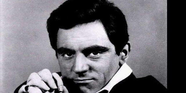 Anthony Newley is seen in a 1965 headshot.