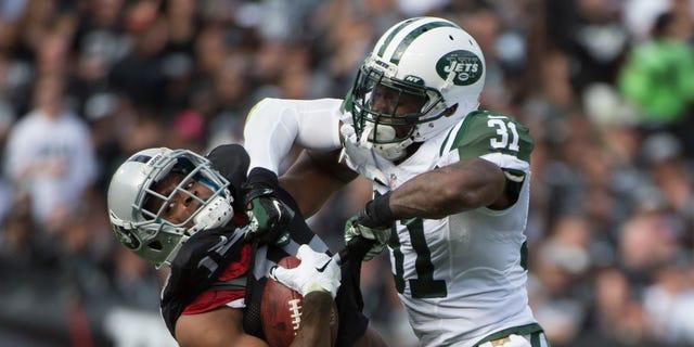 November 1, 2015; Oakland, CA, USA; New York Jets cornerback Antonio Cromartie (31) tackles Oakland Raiders wide receiver Michael Crabtree (15) during the second quarter at O.co Coliseum.