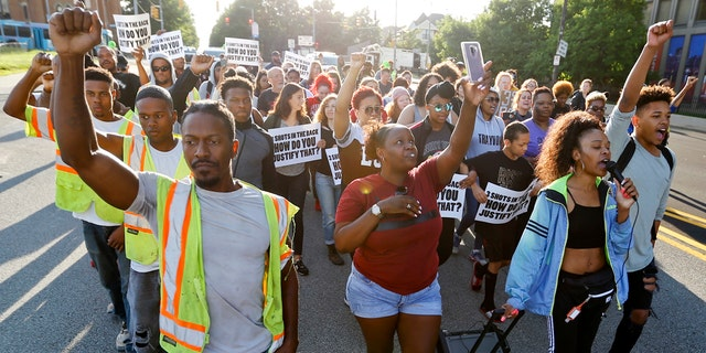 People start a protest march against the shooting death of Antwon Rose Jr. on Tuesday, June 26, 2018, in Pittsburgh. Rose was fatally shot by a police officer seconds after he fled a traffic stop June 19, in the suburb of East Pittsburgh.