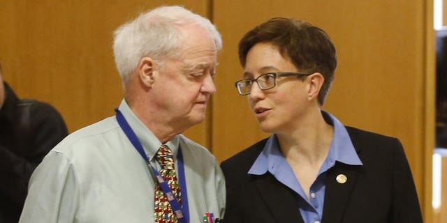 In this Feb. 13, 2015, file photo, Oregon Senate President Peter Courtney, left, and Speaker of the House Tina Kotek confer at the Capitol in Salem, Ore. The two fellow Democrats are being accused of covering up a pervasive culture of sexual harassment at the state capitol.