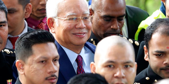 Former Malaysian Prime Minister Najib Razak, center, arrives at a court house in Kuala Lumpur, Malaysia.