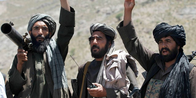 Taliban fighters react 2016 to a speech by their senior leader in the Shindand district of Herat province, Afghanistan.