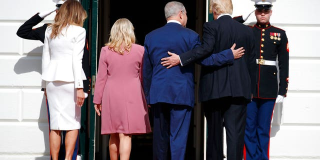 President Donald Trump, first lady Melania Trump, Israeli Prime Minister Benjamin Netanyahu and his wife Sara walk into the White House in Washington.