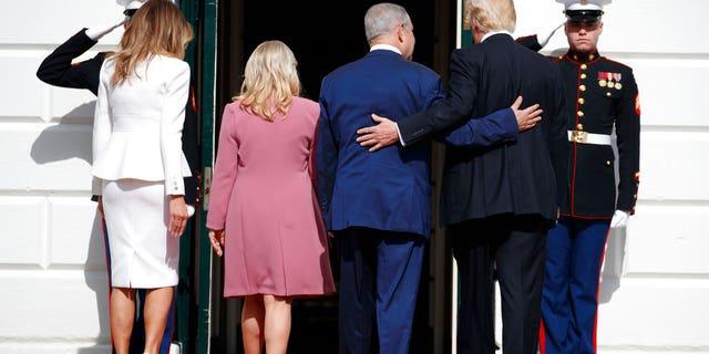 President Donald Trump, first lady Melania Trump, Israeli Prime Minister Benjamin Netanyahu and his wife Sara walk into the White House in Washington.