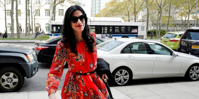 """FILE - In this Nov. 2, 2016 file photo, Huma Abedin is seen in the Brooklyn borough of New York. A person familiar with the investigation into Hillary Clinton's use of a private email server says Abedin did not forward """"hundreds and thousands"""" of emails to her husband's laptop, as FBI Director James Comey testified to Congress. (AP Photo/Mark Lennihan, File)"""