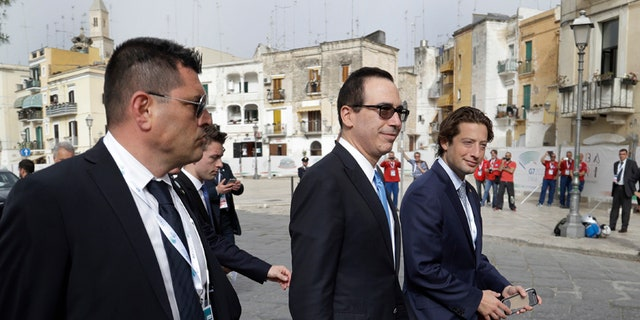 United States Treasury Secretary Steven Mnuchin, center, leaves at the end of a plenary session during a G7 of Finance Ministers and Central Bank Governors meeting, in Bari, southern Italy, Friday, May 12, 2017. (AP Photo/Andrew Medichini)