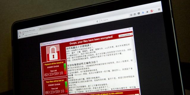 عکس صفحه ای از حمله باج افزار هشدار دهنده که توسط یک کاربر رایانه در تایوان گرفته شده است ، در روز شنبه ، 13 مه 2017 ، در یک لپ تاپ در پکن قابل مشاهده است.
