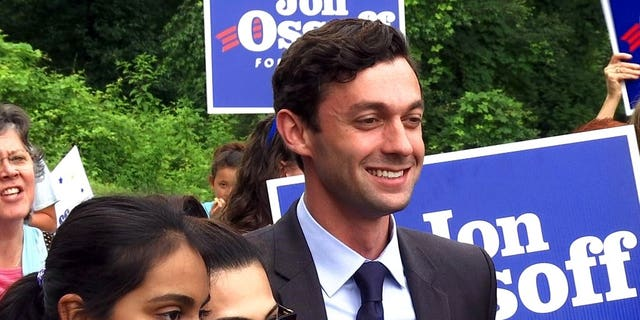 Democrat Jon Ossoff poses for a picture with supporters outside of the East Roswell Library in Roswell, Ga., Tuesday, May 30, 2017. Early voting has begun in the nationally watched special congressional race in Georgia. Ossoff is trying for an upset over Republican Karen Handel in the GOP-leaning 6th Congressional District that stretches across greater Atlanta's northern suburbs. (AP Photo/Alex Sanz)