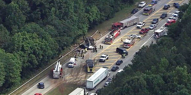 In this image made from video by WSB-TV Atlanta, authorities render assistance to injured people on an overturned church bus, Thursday, June 8, 2017, in Atlanta. Mount Zion Baptist Church in Huntsville, Ala., posted on its Facebook page that one of its buses with its student ministry mission was involved in a crash while traveling to the airport. (WSB-TV via AP)