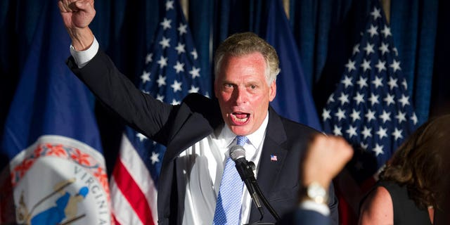 Virginia Gov. Terry McAuliffe celebrates Democratic candidate for governor Ralph Northam's primary win at a Democratic primary election party in Crystal City, Va., Tuesday, June 13, 2017. (AP Photo/Cliff Owen)