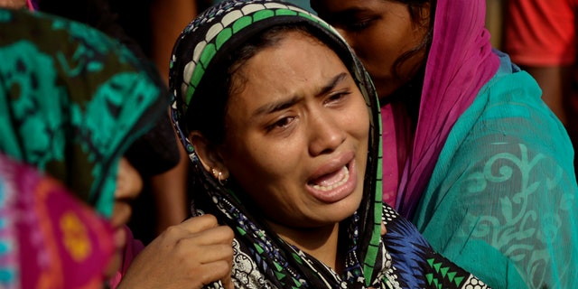 A Bangladeshi woman cries after her relative's body was recovered after Tuesday's massive landslide in Rangamati district, Bangladesh, Wednesday, June 14, 2017. Rescuers struggled on Wednesday to reach villages hit by massive landslides that have killed more than a hundred while also burying roads and cutting power in southeastern Bangladesh, officials said. (AP Photo)