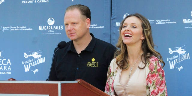 Trapeze-artist Erendira Wallenda smiles as she and her daredevil husband Nik Wallenda describe Erendira's plans to perform an acrobatic routine while suspended from a helicopter above Niagara Falls at at news conference Wed. June 14 2017 at the Seneca Niagara Casino in Niagara Falls, N.Y.