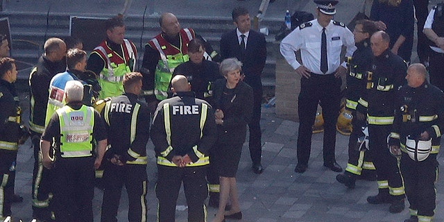 Britain's Prime Minister Theresa May arrives at Grenfield Tower in London, Thursday, June 15, 2017, following a deadly fire in the apartment block.